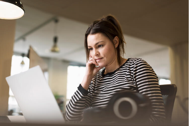 woman sitting in front of her computer