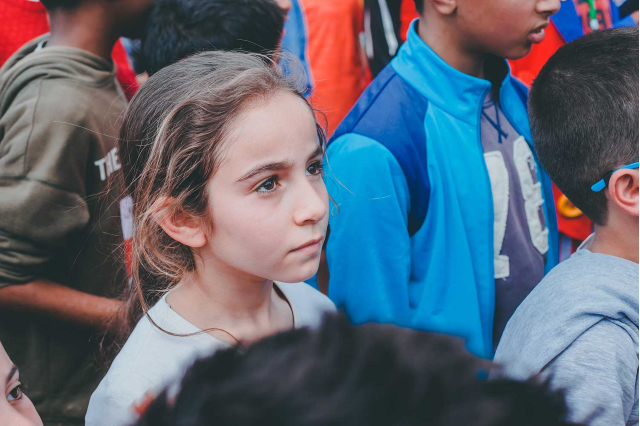 Girl alone in a crowd